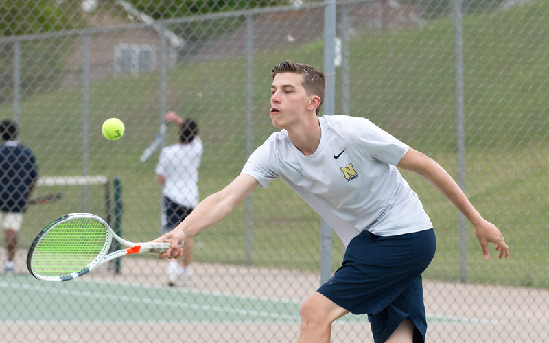 05/09/19  Wesley Bunnell   Staff  Newington boys tennis defeated New Britain at New Britain High School on Thursday afternoon. Newington's number two player Matt Utter.