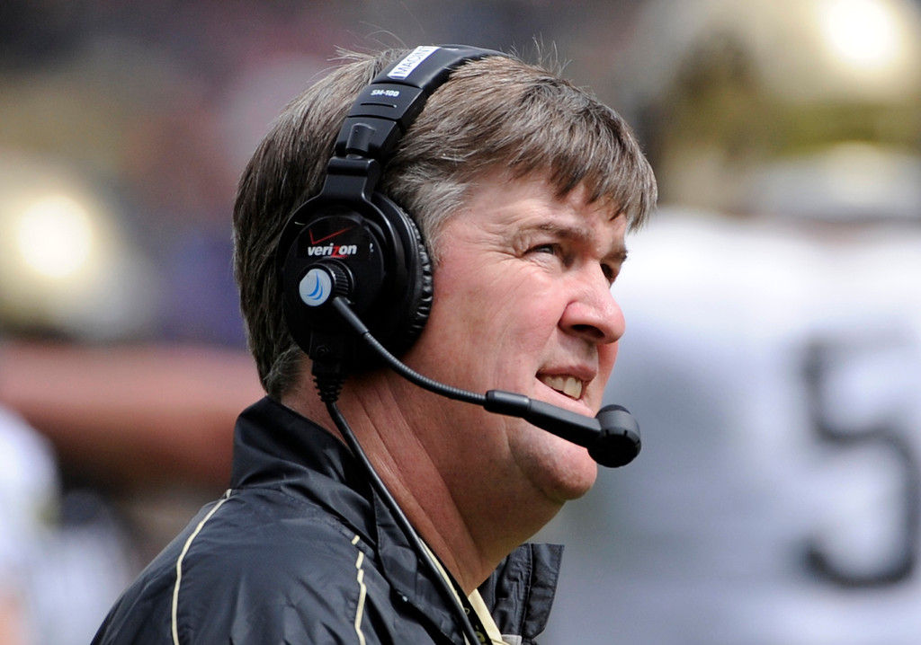 . BOULDER, CO.- APRIL13: New head coach Mike MacIntyre glances up in to the stands. The University of Colorado football team hosts its spring football game at Folsom Field under the direction of new head coach Mike MacIntyre. (Photo By Kathryn Scott Osler/The Denver Post)