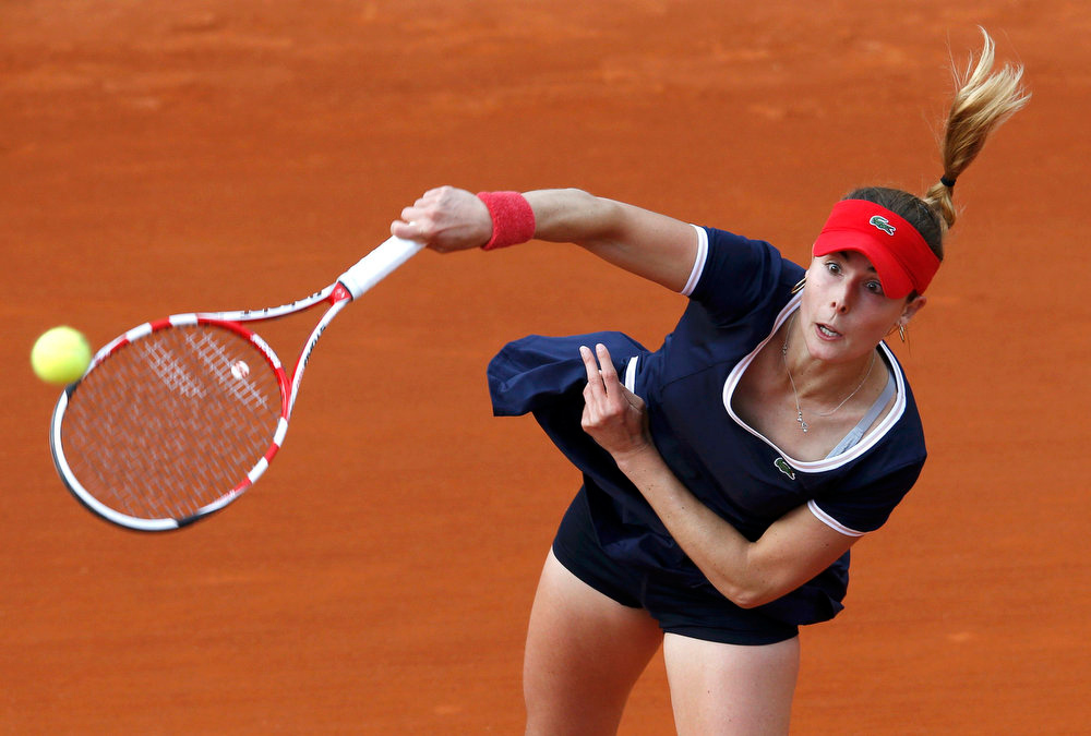 . Alize Cornet of France serves to Maria Joao Koehler of Portugal during their women\'s singles match at the French Open tennis tournament at the Roland Garros stadium in Paris May 28, 2013.   REUTERS/Gonzalo Fuentes