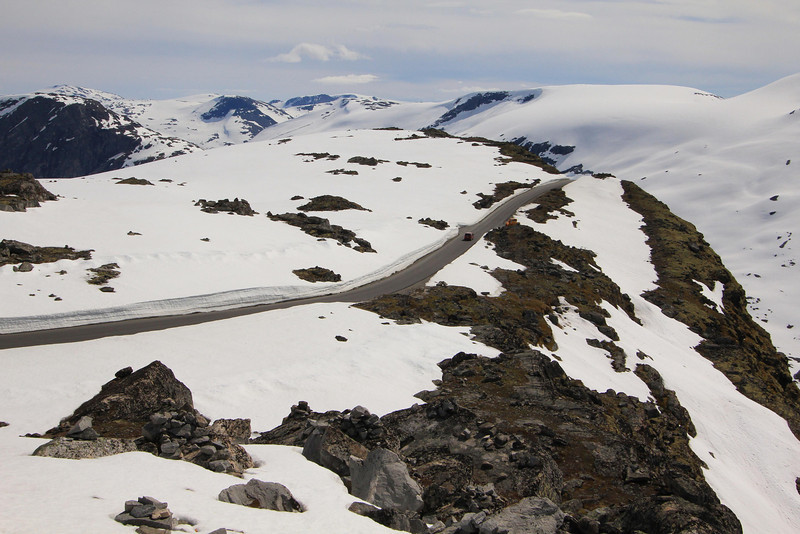 This is the high mountain road from Helleslyt to Mt. Dalsnibba which had only been cleared for use in the past two weeks. The road channel had cuts through the snow deeper than the height of our bus. Late June, 2012.