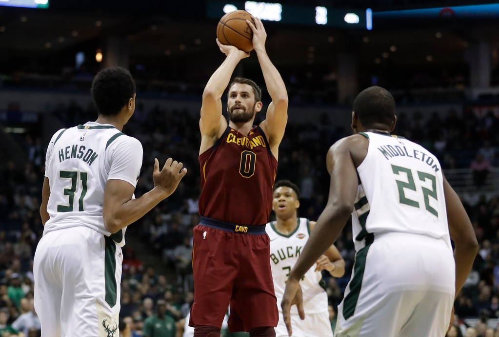 . Cleveland Cavaliers\' Kevin Love shoots during the first half of an NBA basketball game against the Milwaukee Bucks Tuesday, Dec. 19, 2017, in Milwaukee. (AP Photo/Morry Gash)