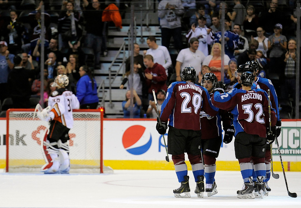 . The Colorado Avalanche celebrate a goal by defenseman Zach Redmond in the second period of an NHL preseason hockey game against the Anaheim Ducks Monday, Sept. 22, 2014 in Denver. (AP Photo/Chris Schneider)