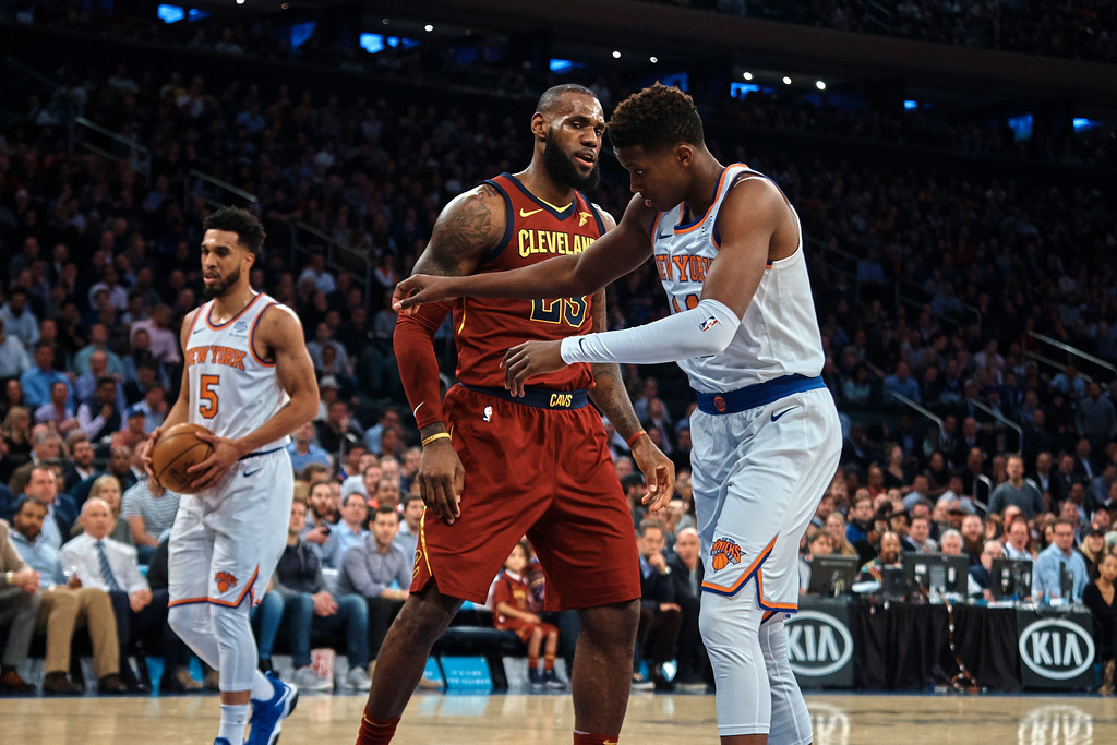 . Cleveland Cavaliers\' LeBron James, center, discusses with New York Knicks\' Frank Ntilikina, right, during the first half of a NBA basketball game at Madison Square Garden in New York, Monday, Nov. 13, 2017. (AP Photo/Andres Kudacki)