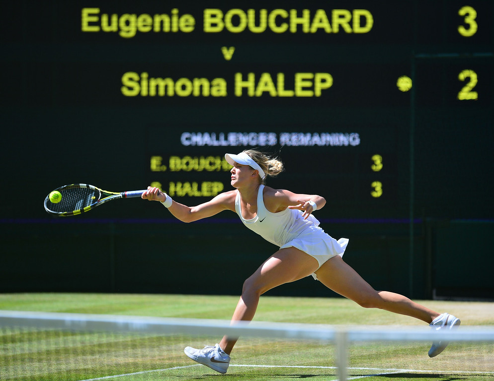 . Canada\'s Eugenie Bouchard returns to Romania\'s Simona Halep during their women\'s singles semi-final match on day ten of the 2014 Wimbledon Championships at The All England Tennis Club in Wimbledon, southwest London, on July 3, 2014.  CARL COURT/AFP/Getty Images
