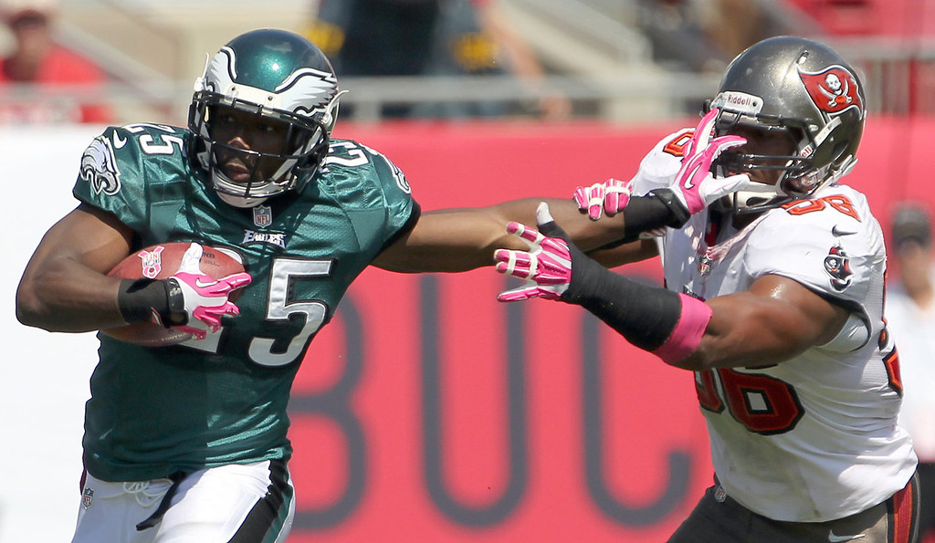 . Philadelphia Eagles\' LeSean McCoy (25) runs with the football against Tampa Bay Buccaneers\' Dekoda Watson, right, during the first quarter of an NFL football game in Tampa, Fla., Sunday, Oct. 13, 2013.  (AP Photo/Philadelphia Daily News, Yong Kim)