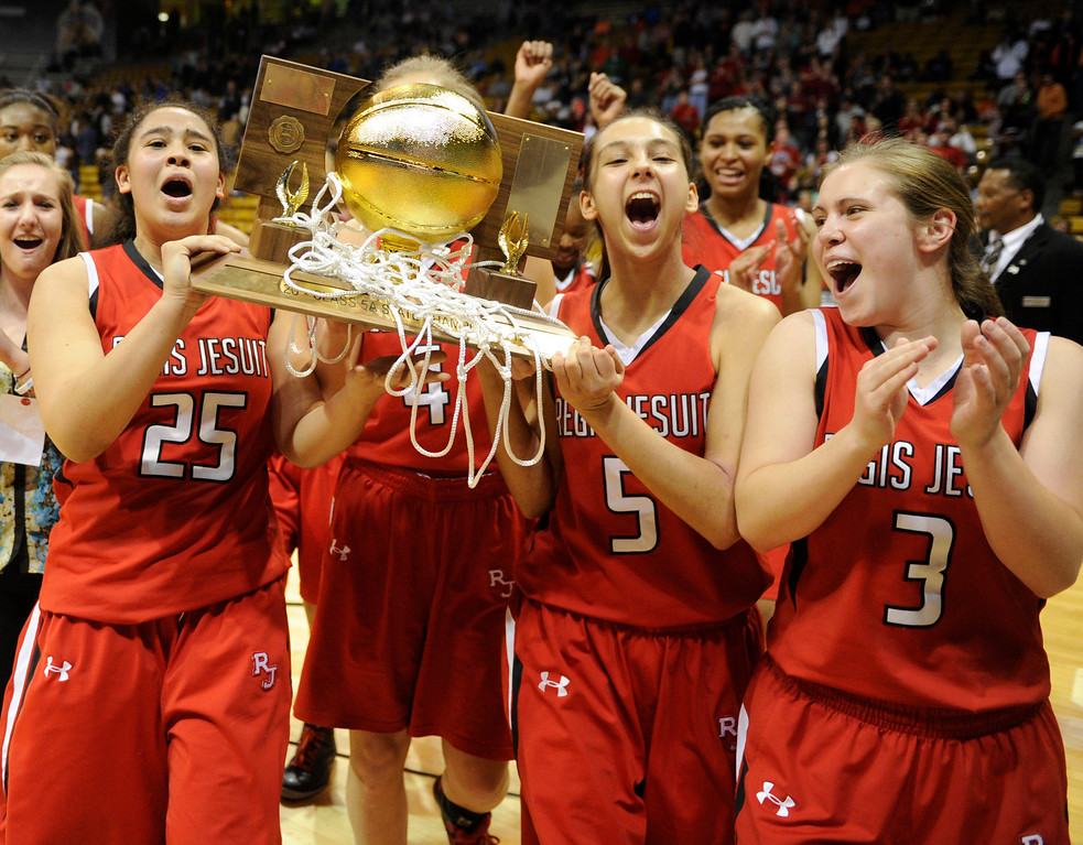 . BOULDER, CO. - MARCH 16: The Raiders celebrated with the trophy. The Regis Jesuit High School girl\'s basketball team defeated Highlands Ranch 53-46 in the 5A championship game Saturday, March 16, 2013 at the Coors Events Center in Boulder.  (Photo By Karl Gehring/The Denver Post)