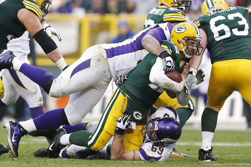 . Aaron Rodgers #12 of the Green Bay Packers gets sacked by Jared Allen #69 of the Minnesota Vikings during the game at Lambeau Field on December 2, 2012 in Green Bay, Wisconsin. The Packers won 23-14. (Photo by Joe Robbins/Getty Images)