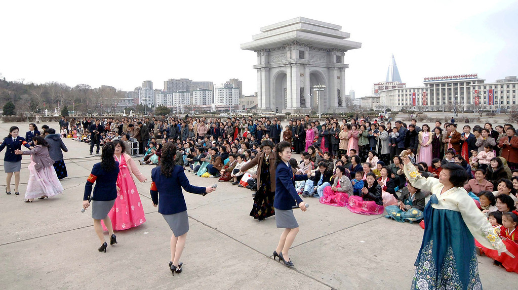 . Participants of the Third April Spring People\'s Art Festival dance during an outdoor performance in Pyongyang, to commemorate the 101st anniversary of the birth of North Korea\'s founder Kim Il-sung, in this photo distributed by North Korea\'s official Korean Central News Agency (KCNA) on April 15, 2013. North Korea celebrated the anniversary of its founder\'s birth on Monday and abandoned its shrill threats of war against the United States and the South, easing tensions in a region that had seemed on the verge of conflict. REUTERS/KCNA