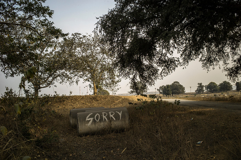 "Chattisgarh, India, February 2015:   ""Sorry"" graffiti - allegedly written by the South Eastern Coalfields Limited employees in one of the villages located on the edge of coal fields.   Photographs for a story on land allocation for coal mines in Chattisgarh.  Modi's new government in the centre has relaxed the environmental regulations so the land can be allocated to both public and private sector companies easily.   Photo by Sami Siva for Al Jazeera America."
