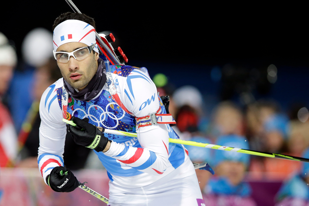 . France\'s Martin Fourcade competes during the men\'s biathlon 4x7.5K relay at the 2014 Winter Olympics, Saturday, Feb. 22, 2014, in Krasnaya Polyana, Russia. (AP Photo/Lee Jin-man)