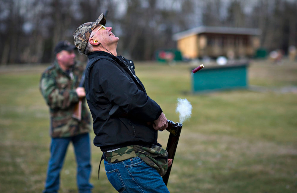 Description of . Rich Korbus reacts after missing his shot while trap shooting at the Vancouver Gun Club in Richmond, British Columbia February 17, 2013. Formed in 1924 the Vancouver Gun Club, which is a shotgun-only club, has a regular membership of about 400 and sells an estimated 1100 day passes each year. Canada has very strict laws controlling the use of handguns and violent crime is relatively rare. Picture taken February 17, 2013.  REUTERS/Andy Clark