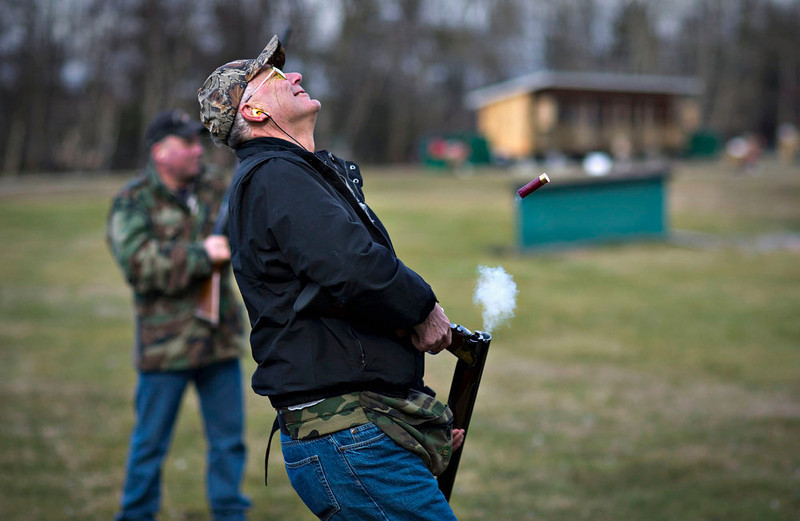 . Rich Korbus reacts after missing his shot while trap shooting at the Vancouver Gun Club in Richmond, British Columbia February 17, 2013. Formed in 1924 the Vancouver Gun Club, which is a shotgun-only club, has a regular membership of about 400 and sells an estimated 1100 day passes each year. Canada has very strict laws controlling the use of handguns and violent crime is relatively rare. Picture taken February 17, 2013.  REUTERS/Andy Clark