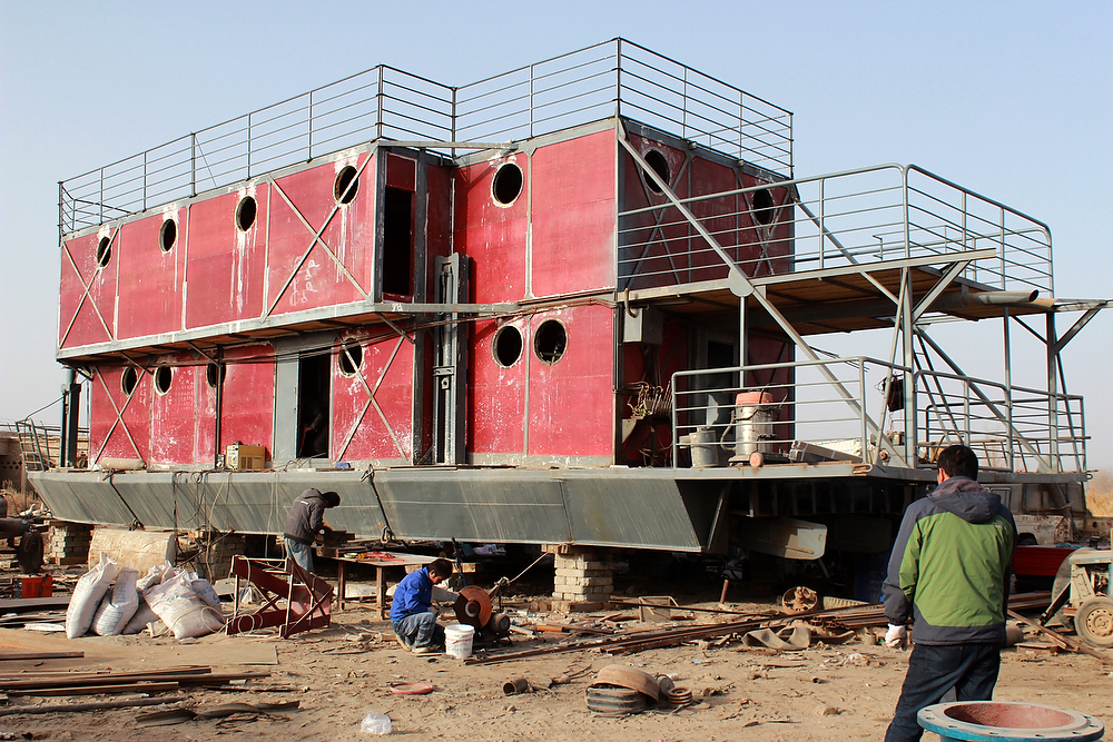 Description of . An unfinished boat built by Lu Zhenhai, a man from Urumqi, Xinjiang Uyghur Autonomous Region. Lu said he was worried that the apocalypse would happen in 2012, so he decided to invest all his money, about 160,500 USD into building what he hopes will be his own indestructible ark. STR/AFP/Getty Images