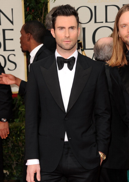 . BEVERLY HILLS, CA - JANUARY 15:  Musician Adam Levine of the music group Maroon 5 arrives at the 69th Annual Golden Globe Awards held at the Beverly Hilton Hotel on January 15, 2012 in Beverly Hills, California.  (Photo by Jason Merritt/Getty Images)