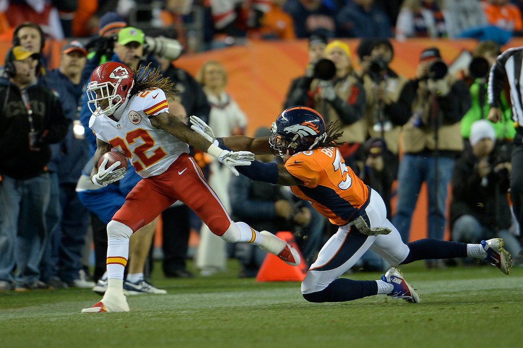 . Kansas City Chiefs wide receiver Dexter McCluster (22) is pushed out of bounds in the first quarter. The Denver Broncos take on the Kansas City Chiefs at Sports Authority Field at Mile High in Denver on November 17, 2013. (Photo by Joe Amon/The Denver Post)