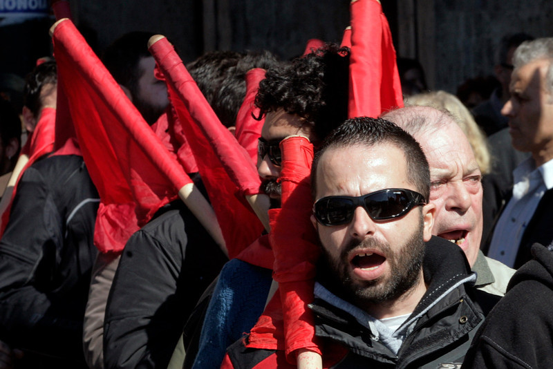 . Workers shouts slogans outside Greece\'s parliament during a protest on February 20, 2013 in Athens, Greece. Unions have launched  general strike against austerity measures in Greece, amid predictions unemployment in the crisis-hit country will reach 30 percent this year. (Photo by Milos Bicanski/Getty Images)