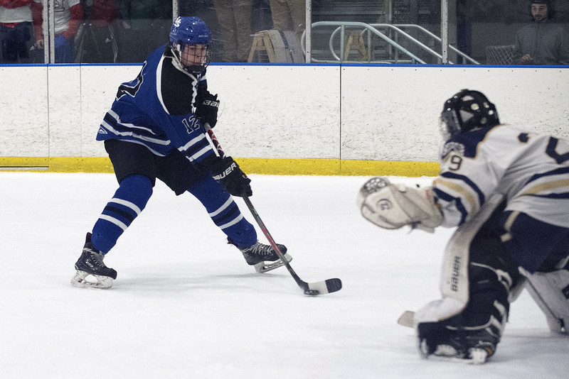 02/26/20   Wesley Bunnell | Staff  Newington Co-op hockey vs Hall-Southington on Wednesday night at Newington Arena. Hall-Southington's Duncan Hollander (12).