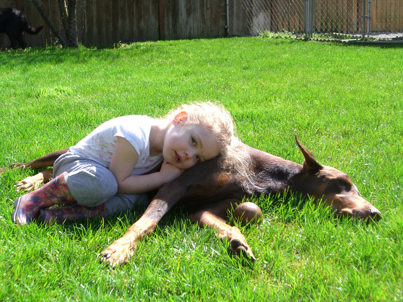 Kimber cuddling up with Slone on a sunny Easter morning in the backyard.
