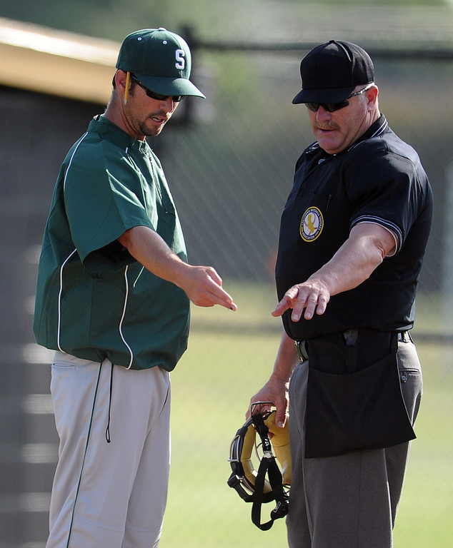 . South (Torrance) head coach Grady Sain talks with the home plate umpire over a call at home plate in the seventh inning of a CIF-SS prep second round playoff baseball game at Northview High School on Tuesday, May 21, 2013 in Covina, Calif. Northview won 5-4. 