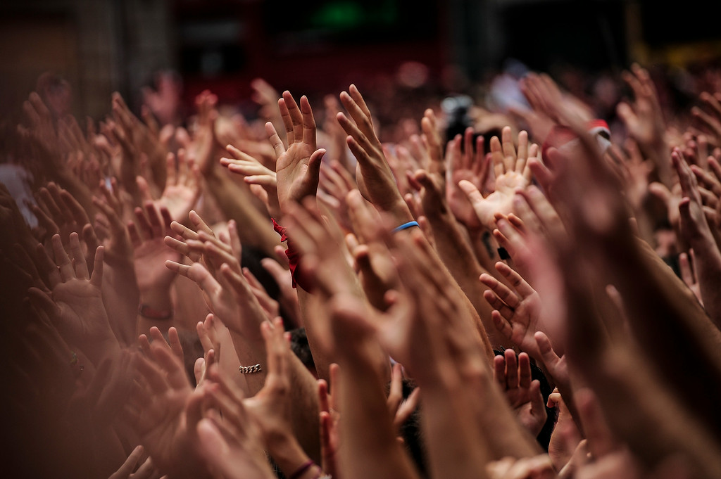 """. Revelers hold up their hands during the launch of the \'Chupinazo\' rocket, to celebrate the official opening of the 2014 San Fermin fiestas, in Pamplona, Spain, Sunday, July 6, 2014. Revelers from around the world kick off the festival with a messy party in the Pamplona town square, one day before the first of eight days of the running of the bulls glorified by Ernest Hemingway\'s 1926 novel \""""The Sun Also Rises.\"""" (AP Photo/Alvaro Barrientos)"""