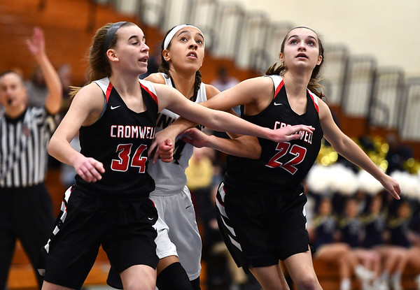 2/8/2020 Mike Orazzi | StaffrNewington's Alexie Armour (4) and Cromwell's Marykate Sullivan (34) and Jessica Grodzicki (22) on Saturday morning in Newington. r
