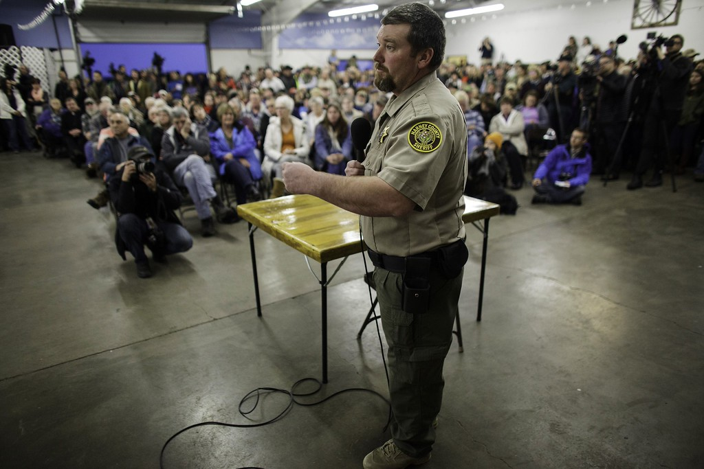 . Harney County Sheriff David Ward addresses citizens in a packed building at the county fairgrounds in Burns, Oregon on January 6, 2016. The meeting was addressing the issues surrounding the takeover of the Malheur National Wildlife Refuge Headquarters by a loose-knit band of farmers, ranchers and survivalists that began January 2, 2016 and attended the public meeting. The leader of a small group of armed activists who have occupied a remote wildlife refuge in Oregon hinted that the standoff may be nearing its end. Speaking to reporters outside the Malheur National Wildlife Refuge, Ammon Bundy said he was aware the occupation that was in its fifth day must end but he added it was too soon to call it quits, Fox news reported. AFP PHOTO/ ROB KERRROB KERR/AFP/Getty Images