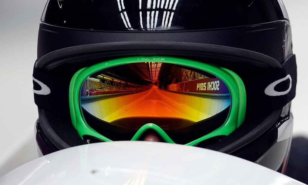 . The track is reflected in the goggles of Canada\'s CAN-2, pilot Jennifer Ciochetti as she start their first run during the women\'s two-man bobsled competition at the 2014 Winter Olympics, Tuesday, Feb. 18, 2014, in Krasnaya Polyana, Russia. (AP Photo/Natacha Pisarenko)