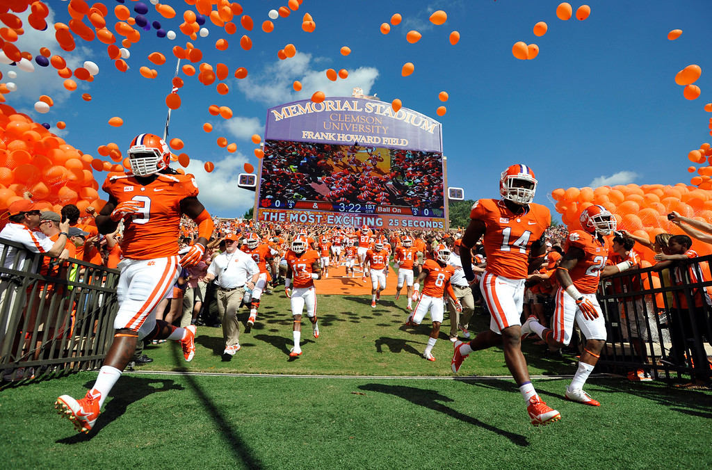 . Clemson defensive tackle Tavaris Barnes (9), defensive back Martin Jenkins (14) and cornerback Garry Peters (26) run to the field before an NCAA college football game against Wake Forest, Saturday, Sept. 28, 2013, in Clemson, S.C. (AP Photo/Rainier Ehrhardt)