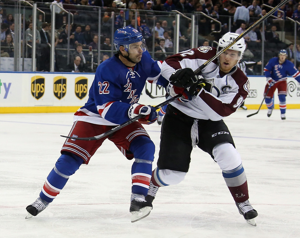 . NEW YORK, NY - NOVEMBER 13: Dan Boyle #22 of the New York Rangers checks Gabriel Landeskog #92 of the Colorado Avalanche at Madison Square Garden on November 13, 2014 in New York City. The Avalanche defeated the Rangers 4-3 in the shootout.  (Photo by Bruce Bennett/Getty Images)