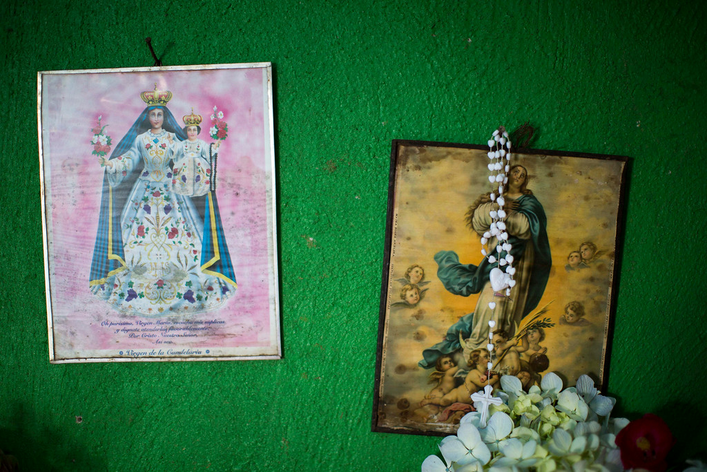 . Two images of the virgin Mary and a rosary hang on a wall at the Ramos Juarez\'s home in the community of San Jose Las Flores, in the northern Cuchumatanes mountains of Guatemala, Tuesday, July 1, 2014. In this small community Gilberto Francisco Ramos Juarez was born, a Guatemalan boy whose decomposed body was found in the Rio Grande Valley of South Texas. The border patrol had found Gilberto Francisco\'s decaying body in the Texas desert near the border. He was shirtless, probably having died of heat stroke, and still wearing a white rosary. (AP Photo/Luis Soto)
