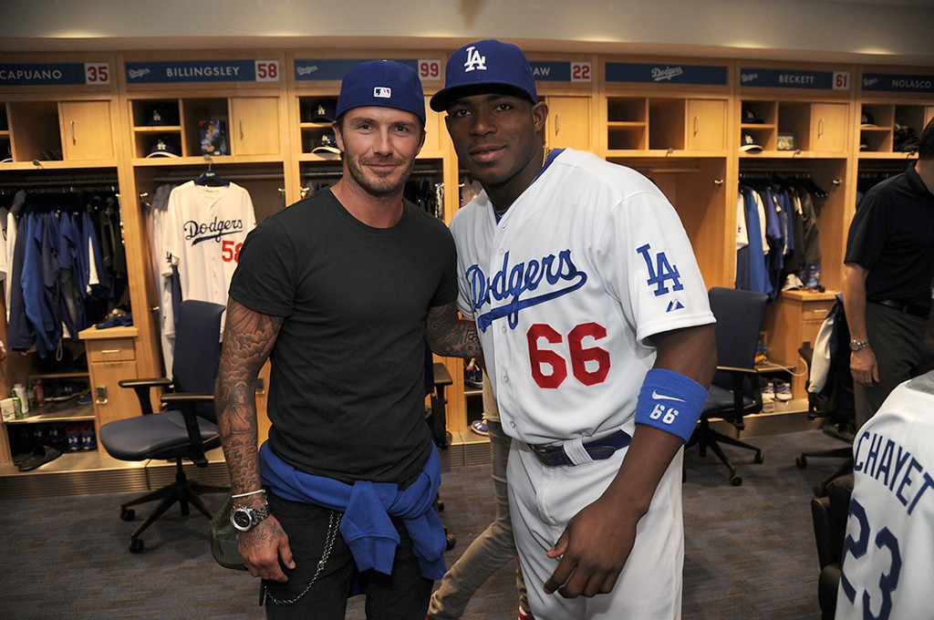. In this handout photo provided by the Los Angeles Dodgers, David Beckham and Los Angeles Dodger player Yasiel Puig pose in the clubhouse at Dodger Stadium on August 27, 2013 in Los Angeles, California. (Photo by Jon Soohoo/LA Dodgers via Getty Images)