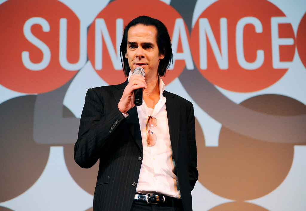 """. Musician Nick Cave, subject of the documentary film \""""20,000 Days on Earth,\"""" takes questions from the audience following the premiere of the film at the Egyptian Theatre, during the 2014 Sundance Film Festival, Monday, Jan. 20, 2014, in Park City, Utah. (Photo by Chris Pizzello/Invision/AP)"""