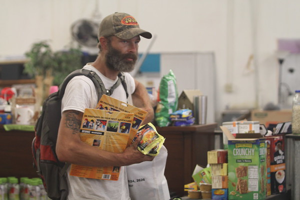 Warehouse giveaway helps Camp Fire families and shows off new community space