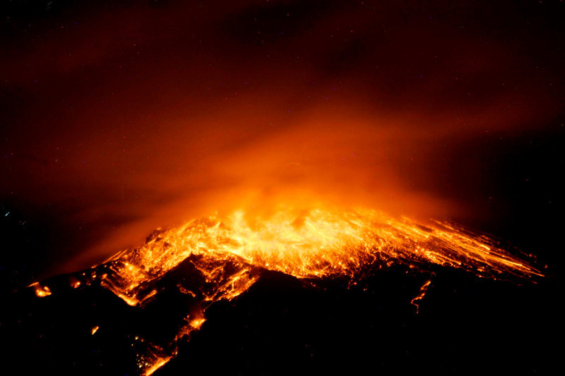 . View of an eruption at the Tungurahua volcano, from the city of Banos, early on December 17, 2012. Ecuador issued an orange alert -- the second-highest warning level -- for towns near the Tungurahua volcano on the eve, as its level of activity rose, civil defense officials said.  AFP PHOTO / Agencia API-/AFP/Getty Images