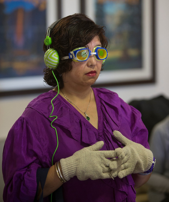 . Angelita Villanueva, of Fremont, wears blurry goggles and thick gloves as she took part in the virtual dementia tour at Atria Burlingame, in Burlingame, Calif. on Saturday, Feb. 9, 2013. The interactive experience included altered senses, confusion, frustration and a struggle to complete simple tasks. (John Green/Staff)