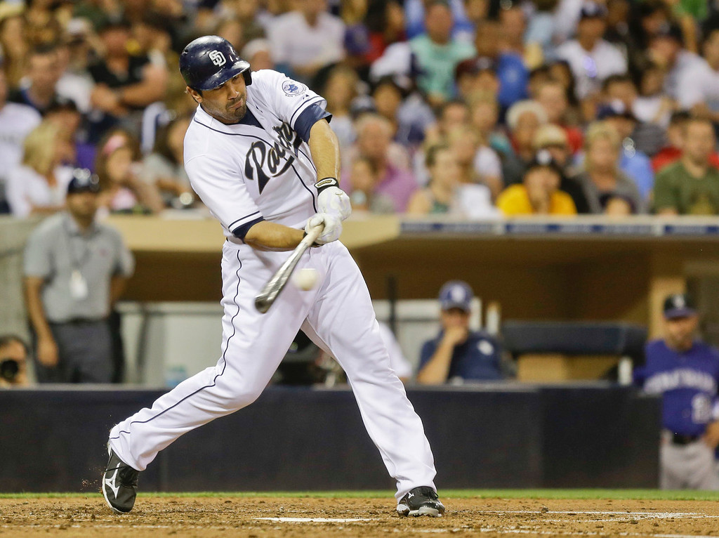 . San Diego Padres\' Carlos Quentin connects for the first Padres\' hit of the game as he singles to centerfield in the fifth inning of a baseball game against the Colorado Rockies in San Diego, Monday, July 8, 2013. (AP Photo/Lenny Ignelzi)