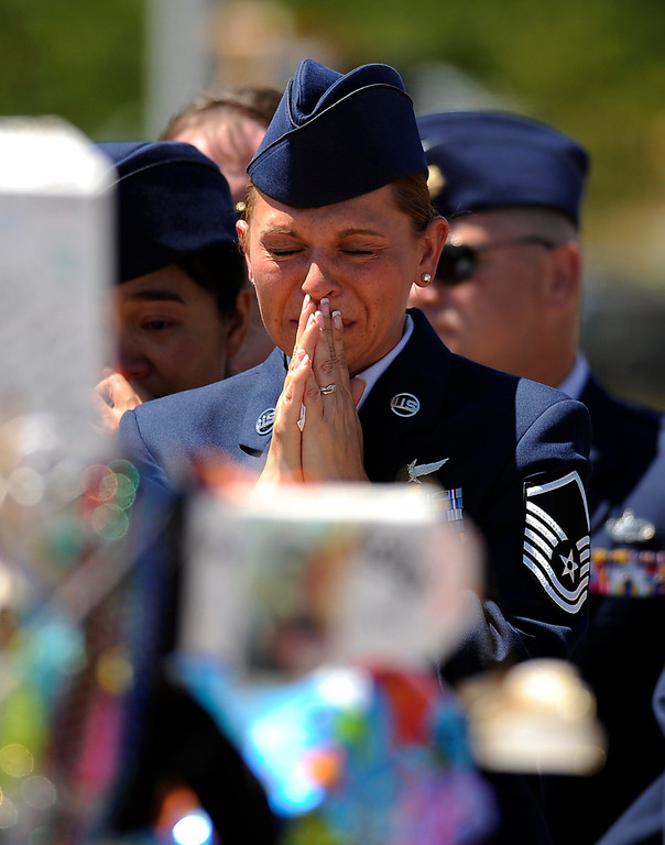 . Raea Thompson, front, and officers from Buckley Air Force Base visit the memorial for shooting victims in Aurora, Colo. Saturday, July 28, 2012. Hyoung Chang, The Denver Post