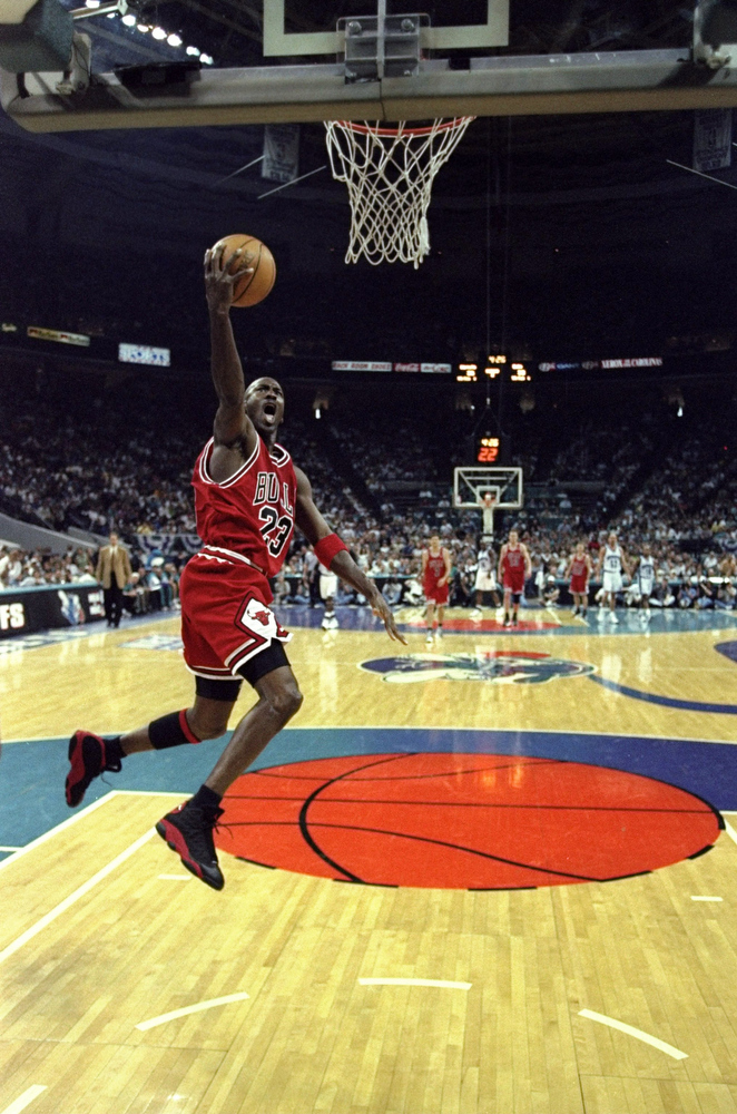 . 10 May 1998:  Michael Jordan #23 of the Chicago Bulls jumps to make a lay-up during the East Conference Semifinals against the Charlotte Hornets at Charlotte Coliseum in Charlotte, North Carolina. The Bulls defeated the Hornets 103-83.  Craig Jones