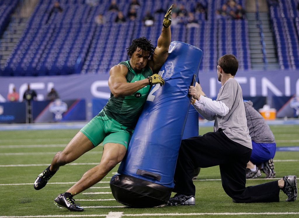 . Clemson defensive lineman Vic Beasley runs a drill at the NFL football scouting combine in Indianapolis, Sunday, Feb. 22, 2015. (AP Photo/David J. Phillip)