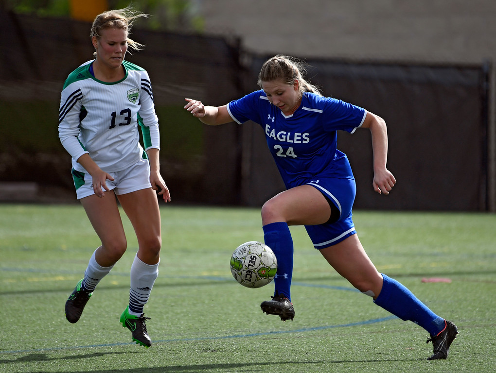 . HIGHLANDS RANCH, CO - MAY 18: Broomfield Michaela Stark (24) controls the ball away from ThunderRidge Amanda Chamness (24) during the first half in girls quarterfinals May 18, 2016 at Shea Stadium. (Photo By John Leyba/The Denver Post)