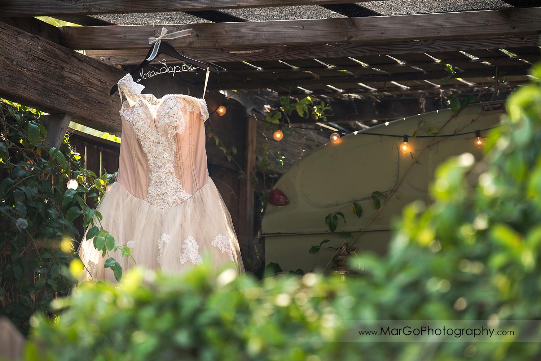 wedding dress hanging in bride's preparation side at Taber Ranch Vineyards