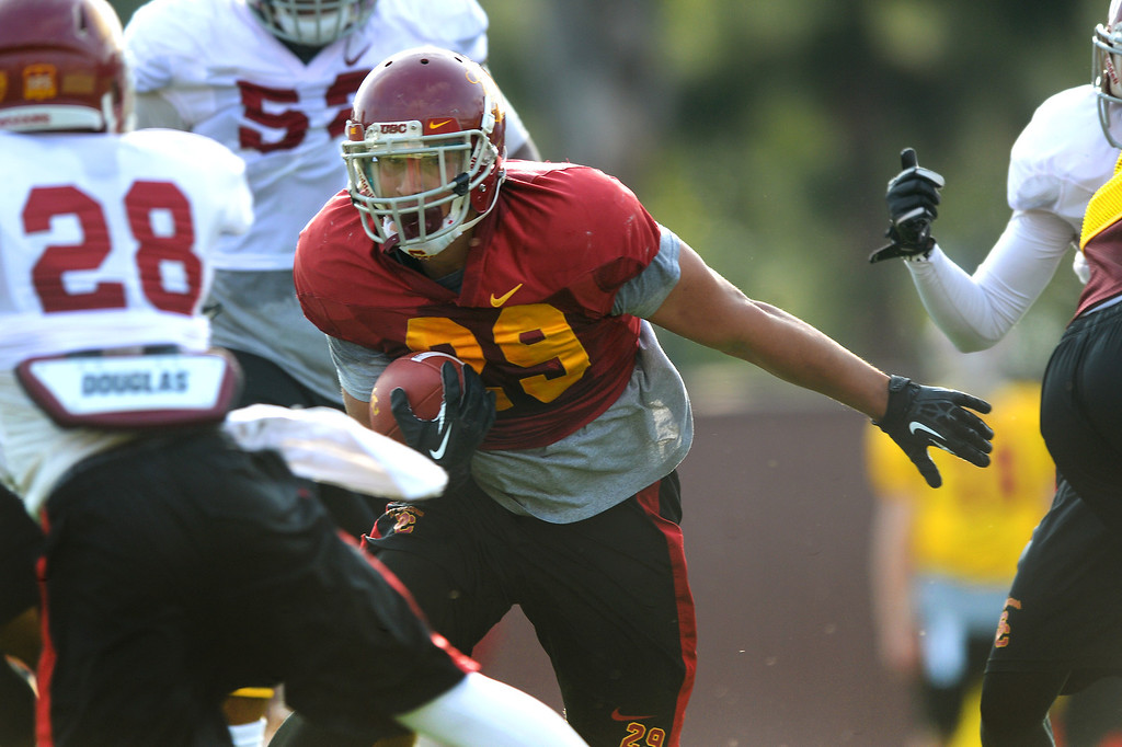 . USC RB Ty Isaac cuts upfield during practice, Tuesday, March 25, 2014, at USC. (Photo by Michael Owen Baker/L.A. Daily News)