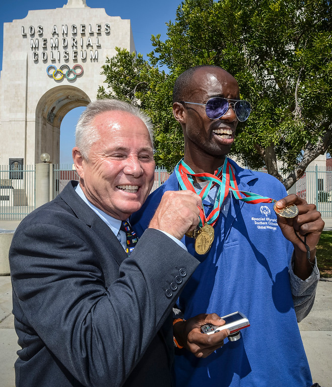 . Los Angeles city councilman Tom LaBonge shows off the medals of special olympian Jayson Warsuna at the announcement of the 2015 Special Olympics World Games to be held in Los Angeles.   Photo by David Crane/Staff Photographer
