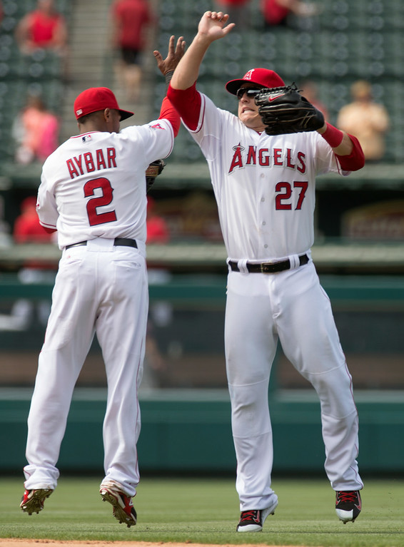 . Angels\' Mike Trout (#27) and Erick Aybar (#2) celebrate their win over the Minnesota Twins at Angel Stadium in Anaheim on Thursday June 26, 2014. The Angels beat the Minnesota Twins 6-4. (Photo by Keith Durflinger/Whittier Daily News)