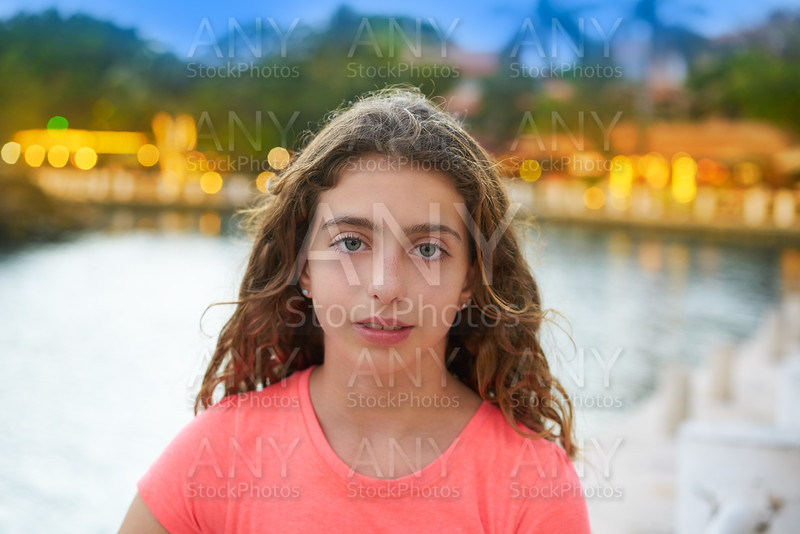 Girl portrait sunset with lights background
