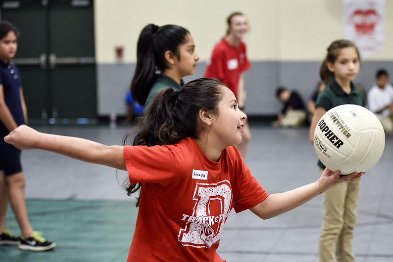 Annaya Leon, 9, serves the ball during Sports Day hosted by Robert E. Lee students at Douglas Elementary School in Tyler, Texas, on Friday, May 19, 2017. The event was organized in part by teacher Mrs. Jones and her son Royland Black as a way to motivate and reward students for their hard work at the end of the school year. (Chelsea Purgahn/Tyler Morning Telegraph)