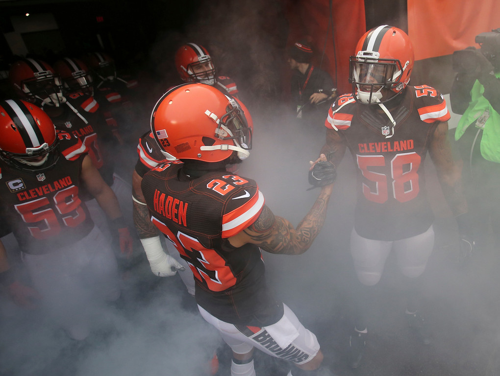 . Cleveland Browns cornerback Joe Haden (23) and Christian Kirksey shake hands before an NFL football game against the San Diego Chargers, Saturday, Dec. 24, 2016, in Cleveland. (AP Photo/Aaron Josefczyk)