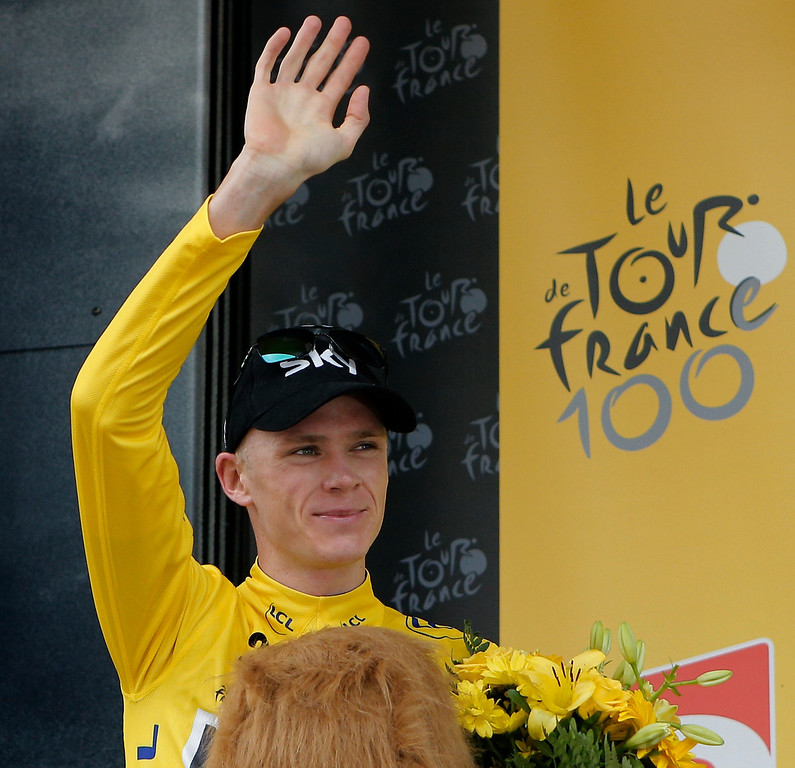. Stage winner Christopher Froome of Britain, wearing the overall leader\'s yellow jersey, celebrates on the podium of the seventeenth stage of the Tour de France cycling race an individual time trial over 32 kilometers (20 miles) with start in Embrun and finish in Chorges, France, Wednesday July 17, 2013. (AP Photo/Christophe Ena)