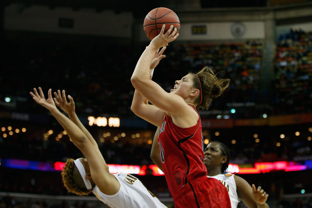 Description of . Sara Hammond #00 of the Louisville Cardinals shoots the ball over Layshia Clarendon #23 of the California Golden Bears during the National Semifinal game of the 2013 NCAA Division I Women's Basketball Championship at the New Orleans Arena on April 7, 2013 in New Orleans, Louisiana.  (Photo by Chris Graythen/Getty Images)