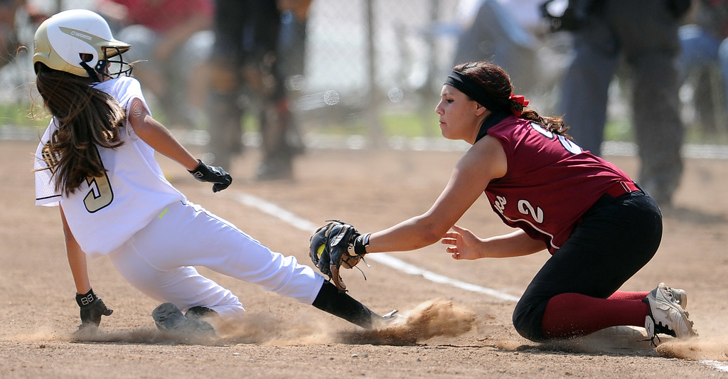 . Barstow shortstop Aleesha Rodriguez (2) tags out Northview\'s Tyler Martinez (3) at third base in the second inning of a CIF-SS quarterfinal playoff softball game at Northview High School on Thursday, May 23, 2013 in Covina, Calif. Northview won 5-4.  (Keith Birmingham Pasadena Star-News)